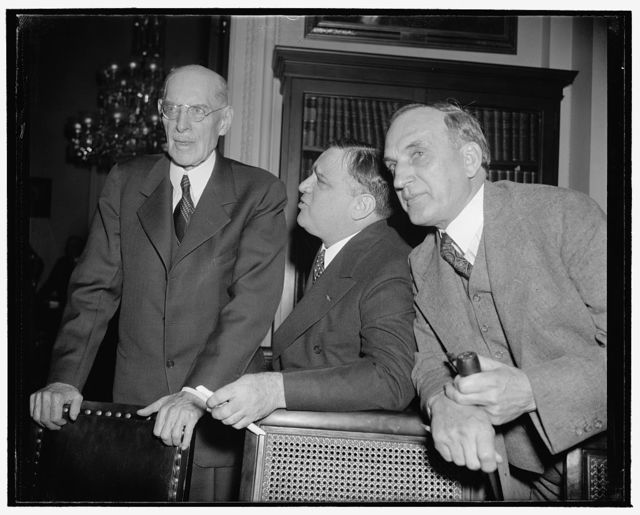 N.Y. Mayor pleads for more relief money. Washington, D.C., Jan. 9. New York's Mayor Fiorello La Guardia, appearing before the House Appropriations Subcommittee today, proposed that Congress provide $915,000,000 to finance relief until July 1 instead of the $875,000,000 recommended by President Roosevelt. La Guardia, representing the conference of United States Mayors, said Mr. Roosevelt's recommendation is 'not enough' to meet the needs of the WPA until the end of the fiscal year. Left to right, can be seen: Rep. Edward T. Taylor, Chairman of the committee; Mayor La Guardia; and Rep. J. Buell Snyder of Pennsylvania, a member of the committee, 1/9/39