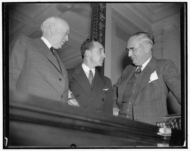 Off the record. Washington, D.C., Dec. 6. Following his appearance before the Senate Finance Subcommittee today, Edsal [i.e. Edsel] Ford chats informally with Chairman Clyde Herring, left, and Senator Arthur M. Vandenberg, Republican of Michigan