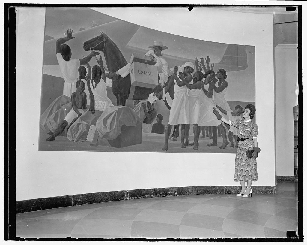 """Off with the yoke of Uncle Sam depicted in post office mural, is charge of Arctic explorer. Washington, D.C., Sept. 10. Vilhjamur Stefansson, the Artic explorer, today charged that artist Rockwell Kent had painted on the wall in the Post Office Building here an exhortation to Puerto Rico to throw off American Rule. The gibberish, says Stefansson, [...]s translated by his friends and reads: """"To the people of Puerto Rico, our friends: go ahead, let [...] change chiefs. That alone can make us equal and free"""". Postmaster General Farley passes the mural each day as he goes to his office. Miss Mary [....]eveling is viewing the mural in this picture, 9/10/37"""