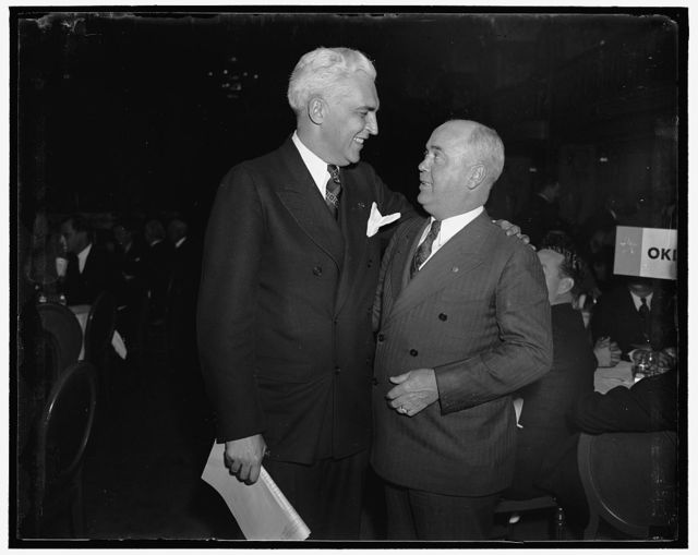 Oklahoma and Indiana bosses meet at Governors' luncheon. Washington, D.C. Governor James Berry of Oklahoma, (left) and Paul V. McNutt, former Governor of Indiana, meet at the housing luncheon given for state Governors today at the Mayflower Hotel