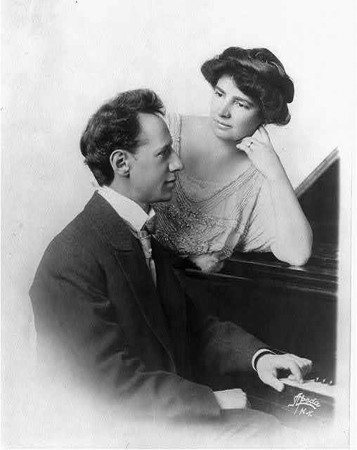 [Ossip Gabrilowitsch, 1878-1936, half-length portrait, seated at piano, right profile, with wife Clara Clemens]