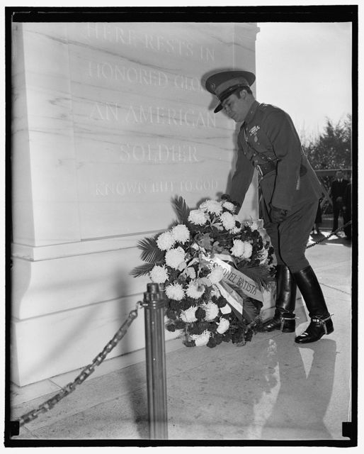 Pays homage to America's Unknown Soldier. Washington, D.C., Nov. 12. Cuba's Dictator, Col. Fulgencio Batista, placing a wreath on the Tomb of the Unknown Soldier in Arlington National Cemetery today, 11/12/38