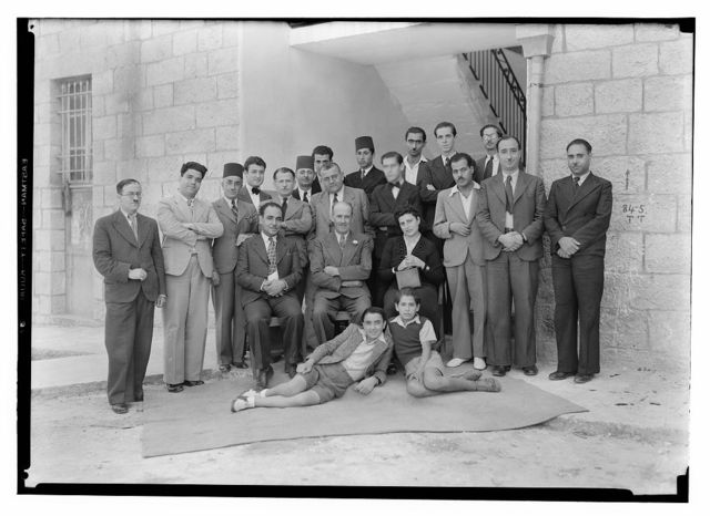 "P.B.S. [i.e., Palestine Broadcasting Service] and P.J[?].O. groups, Mr. Tweedy's farewell groups. Group at Arab section of P.B.S. with Arab ""Tacht"" [i.e., Takht] musicians"