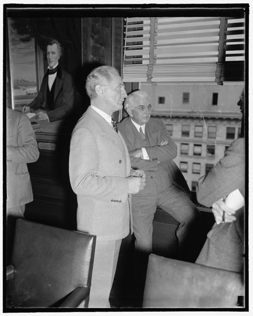 Pictured at Rail Labor-Management Meeting. Washington, D.C., Nov. 7. E.E. Norris, President of the Southern Railway, and Carl Gray, right, Chairman of the Board, Union Pacific, chat as the wait for the President's Special Railroad Committee to meet at the Southern Railway Office here today. The Committee discussed proposed recommendations for legislative aid to the rail industry, 11/7/38