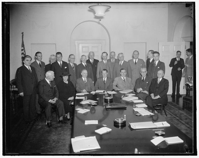Plan for taking of unemployment [...] Washington, D.C., Sept. 27. Government [...]labor leaders met at the White House today [...] John D. Biggers, Unemployment Census Administrator to formulate plans for compiling the first unemployment census in the United States. In the photograph, left to right (seated): A.F. Whitney, Pres. Brotherhood of Railroad Trainman; Secretary of Labor Perkins; Secretary of Commerce Roper; Administrator John D. Biggers; Secretary of Agriculture Wallace; Stuart A. Rice, Chairman, Central Statistical Board; William L. Austin, Director of the Census. Standing, left to right: John L. Lewis, CIO Head; W. Averill Harriman, Chairman of the Business Advisory Council; Allen Johnstone, Counsel of the Special Senate Committee to Investigate Unemployment Relief; Dorrington Gill, substituting for Harry Hopkins; M.W. Thatcher, Pres. of the Farmer National Cooperative Grain Corp.; George H. Davis, Pres. of U.S. Chamber of Commerce; W. Frank Persons, Director of U.S. Employment Service; Chester M. Gray, Representing the American Farm Bureau Federation; Noel Sargent, Secretary of the National Association of Manufacturers; Fred Breckman, representing the National Grange; T.B. Uttley, Supt. Division Post Office Service; Boris Shif[...], representing William Green; and Arthur Altmeyer [...] Security Board, 9/27/37
