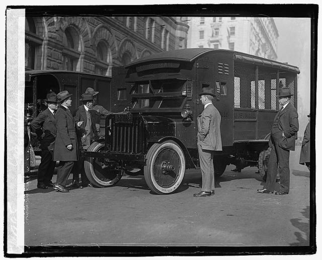 Postmaster General Will Hayes and other Post Office officials inspecting the new armoured trucks which it is proposed to put into use as a means of protection for the mails, 12/1/21