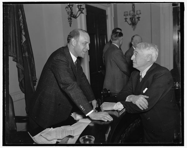 Preparedness is best to keep out of war. Washington D.C. Representative Lister Hill (left), Chairman of the Military Affairs Committee of the House is shown talking to Bernard M. Baruch a New York financier who testified before the Committee today. He stated that the cash on the line was one of the best methods to take the profits out of war and to widen the scope of the 95% taxation on incomes during the war period