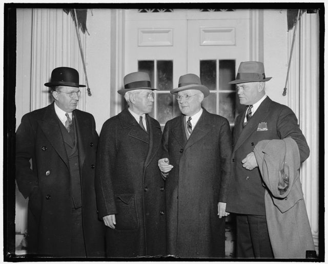 President and A.F. of L. leaders discuss wage-hour legislation. Washington, D.C., March 16. Following a conference between President Roosevelt and leaders of the American Federation of Labor on wage-hour legislation today, AF of L President William Green announced that there was not a great deal of difference between the chief executive and the federation over details of the proposed legislation. He said the federation was not rigidly committed [...] an absolute 40 cents an hour minimum wage. In the picture, left to right: B.M. Jewell, president, Railroad Employees Dept., John Frey, president, Metal Trades Dept., President William Green, and Joseph McInerny, president, Building Trades Dept.