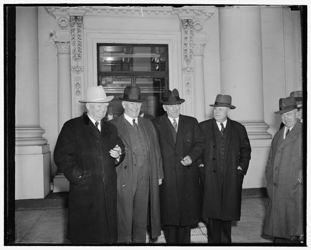 President and Congressional leaders get-together. Washington, D.C., Jan. 9. President Roosevelt today revived his Monday morning White House conferences with the 'big four' of Congress and read to them the special message he is writing on national defense to be sent to Congress probably tomorrow. Leaving the White House are, left to right. Vice President Garner, Senate majority Leader Barkley, speaker Bankhead and House Majority Leader Rayburn, 1/9/39