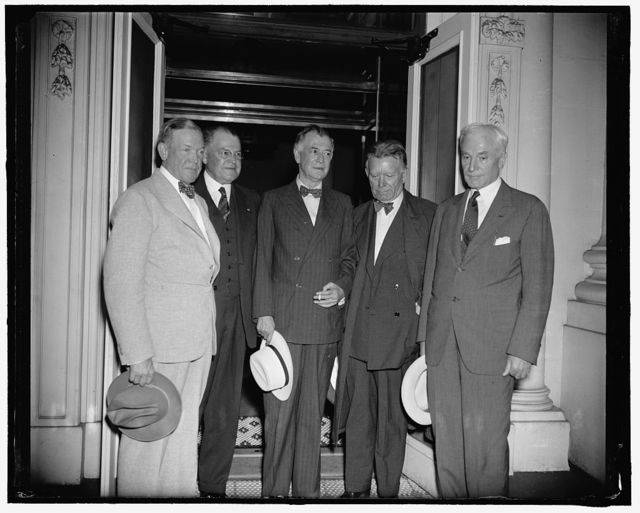 President calls conference of Senate and State Department on neutrality. Washington, D.C., July 18. It was almost midnight tonight when Senators began emerging from the White House after their conference with President Roosevelt and Secretary of State Hull at which an agreement was reached to allow neutrality legislation to lie dormant until next session, thus, apparently ending a flare-up between congress and the president on the neutrality issue which began when the Senate Foreign Relations Committee refused to take up the question this session. Left to right: Senator Charles L. McNary, Minority leader; Sen. Warren Austin of Vermont; Sen. Key Pittman, Chairman of the Foregin Relations Committee; Sen. William E. Borah of Idaho, and Secretary of State Cordell Hull. Senator Alben Barkley, Majority Leader and Vice President Garner remained inside to talk further with the president