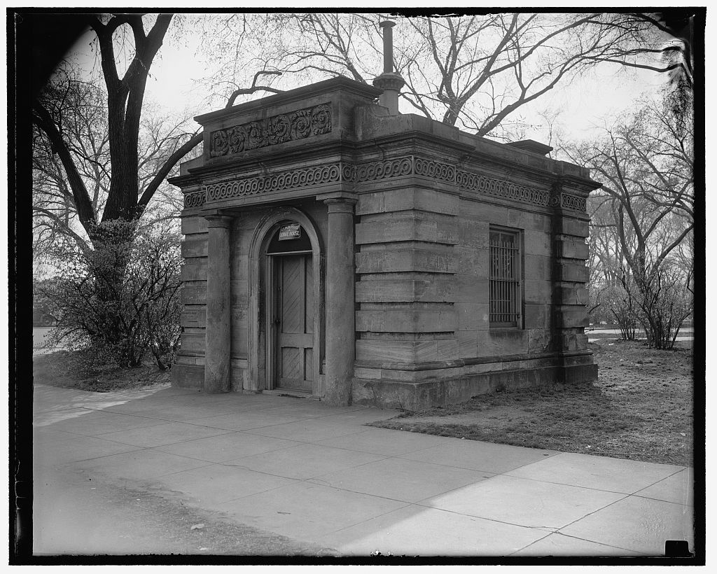 President favors replacing of gatehouses at White House. Washington, D.C., March 25. Designed by Charles Bullfinch and placed on the U.S. Capitol grounds in 1827, this gatehouse was removed in 1872 to its present site on Constitution Ave. President Roosevelt has indicated to the Fine Arts Commission that favors preservation of the gatehouses, of which there are two, and that they should be replaced at their original location in the Capitol grounds, 3/25/38