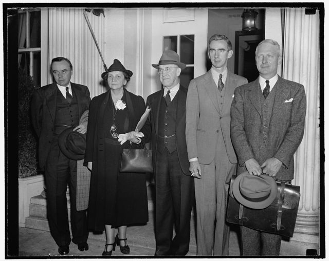 President gets progress report on Wage-Hour law. Washington, D.C., Oct. 31. A thorough report on the progress of the new Wage- Hour Law was given President Roosevelt today by Secretary of Labor Frances Perkins, Wage-Hour Administrator Elmer Andrews, and their assistants today. Reading, left to right. Administrator Elmer Andrews; Secretary Perkins; Richardson Saunders, Assistant to the Secretary of Labor. Gerard D. Reilly, Labor Dept. Solicitor and CA-Vert Magruder,Chief Counsel for Wage-Hour Administration, 10/31/38