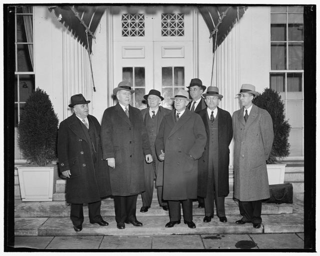 President receives legislative program of American Farm Bureau. Washington, D.C., Jan. 10. The legislative program of the American Farm Bureau, calling for modification of hours and wages of relief labor and suggesting that both industry and labor refrain from advancing prices and wage rates, was presented to President Roosevelt today. In the group, left to right: O.O. Wolf of Kansas; E.A. O'Neal of Alabama, President of the American Farm Bureau; George M. Putnam of New Hampshire; H.J. King of Wyoming; Donald Kirkpatrick, legal counsel; J.F. Porter of Tennessee; and W.R. Ogg of the Research Division of the Bureau, 1/10/39