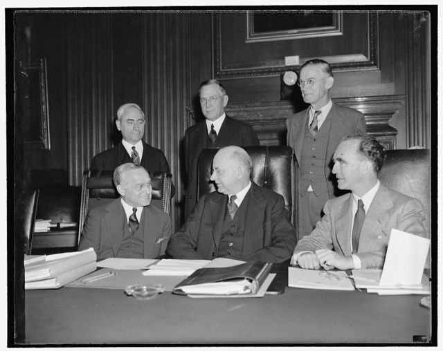 President's committee for civil service improvements open public hearings. Washington, D.C., Nov. 1. The committee which president recently appointed to study possible reforms in recruiting governmental legal help, began open hearings today at the United States Supreme Court Building. This first photograph of the committee shows, left to right, seated: Associate Justice Felix Frankfurter, Associate Justice Stanley F. Reed, chairman, and Attorney General Frank Murphy