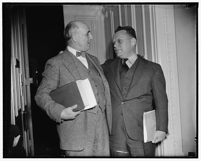 "Pro and con. Washington, D.C., March 28. Fiery Rep. Maury Maverick (right) of Texas, today started a House revolt against Senate Majority Leader Barkley's resolution for an investigation of the Tennessee Valley Authority. He declared the Senate resolution is the foundation for a ""purge trial"" to get rid of Dr. Arthur E. Morgan, deposed Chairman of the T.W.A. Rep. Andrew J. May, (left) Democrat of Kentucky, is warmly supporting the resolution for an investigation, 3/28/38"
