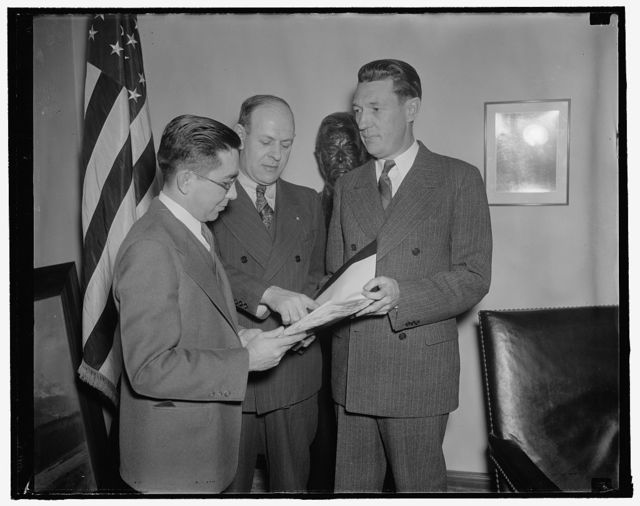 Protest seating of Milton. Washington, D.C., Jan. 24. Labor's Non-Partisan League today filed a protest with the Senate against the seating of John Milton, appointed to the seat vacated by Gov. A. Harry Moore of New Jersey. In the photograph, left to right: Louis Friday, Clerk to Vice President Garner who accepted the protest; Carl Hoederman, Chairman of New Jersey Non-Partisan League; and E.L. Oliver, Vice President of National Labor Non-Partisan League, 1/24/38