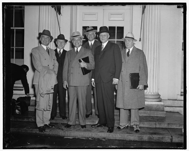 Rail management and Labor executives confer with President Roosevelt. Washington, D.C., Sept. 20. Following a conference today with representatives of Railway Management and Labor at the White House, President Roosevelt announced that he had named an informal six-man committee to devise a broad plan of rail aid legislation for the next congress. The committee comprises three rail management executives and three rail labor chiefs. Attending today's conference were, left to right: Ernest E. Norris, President of the Southern R.R.; D.B. Robertson, representing locomotive firemen and engineers; George M. Harrison, President, Brotherhood of Railway and Steamship Clerks; Carl B. Gray ; Vice Chairman of the Union Pacific R.R.; M.W. Clement, President of Penna. R.R.; and B.M. Jewell, President, Railway Employees, A.F. of L., 9/20/38