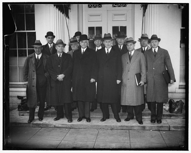 Railroad parley at White House. Washington, D.C., March 15. Representatives of Railroad Management, Labor and Government officials and Congress met with President Roosevelt today in efforts to find a remedy to aid the Nation's financially distressed railroads. In the front row, left to right: ICC Commissioner Joseph D. Eastman; ICC Commissioner Charles D. Maraffie; Carl Gray, President of Union Pacific R.R.; Secretary of Treasury Henry Morgenthau; George Harrison; William O. Douglas, Chairman of the SEC. In the rear, left to right: Ernest G. Draper, Asst. Sec. of Commerce; Dr. W.W. Alexander, FSA; Rep. Clarence F. Lea; Sen. Burton K. Wheeler; and Sen. Harry Truman, 3/15/38