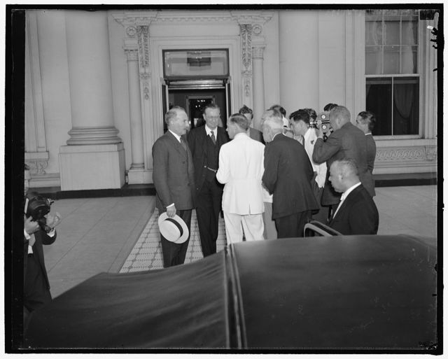Reporters quiz French and British ambassadors following their conference with president. Washington, D.C., June 15. Reporters and cameramen surround the French Ambassador Count Rene De Saint-Quentin, left, and British Ambassador Lord Lothian as they left the White House today following a requested conference with President Roosevelt. The envoys refused to amplify the statement 'the meeting cleared up a lot of things in our minds' which they made to the newsmen