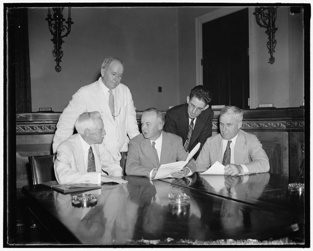 Representatives of Farm group before House Agriculture Committee. Washington D.C. July 27. Congressional sponsors placed before the House Agriculture Committee their hopes for a farm price stabilization bill for this session. They said that immediate legislation is necessary to prevent excessive surpluses and low prices in 1939. Left to right: John D. Miller, President of the National Cooperative Council; Edward A. O'Neal, president of the American Farm Bureau; Rep. Marvin Jones of Texas, Chairman of the House Agriculture Committee; Edward F. Kennedy, Brenckman of the National Grange. 7/27/37