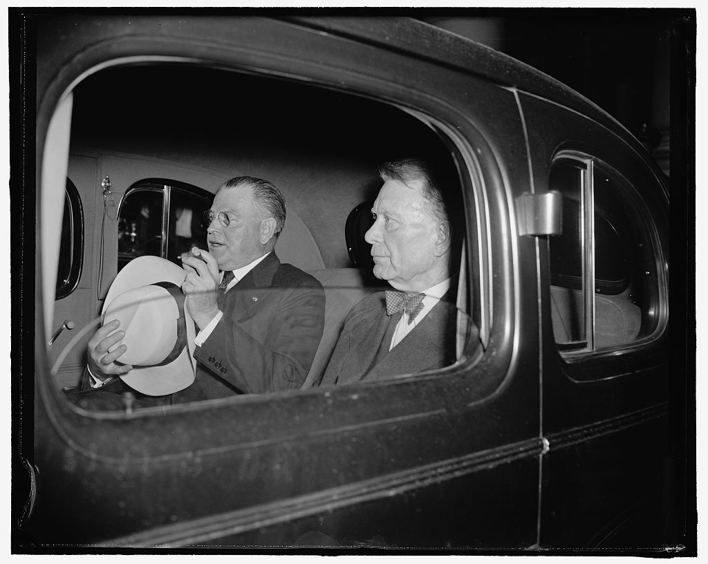 Republican Senators leave White House after conference with president. Washington, D.C., July 18. Appearing a bit wan after the night conference which the President called for tonight, Senators Warren Austin and William E. Borah were snapped in their car as the drove away from the White House steps after it was decided in the conference to let the neutrality question ride until [...], both are Republican [...]