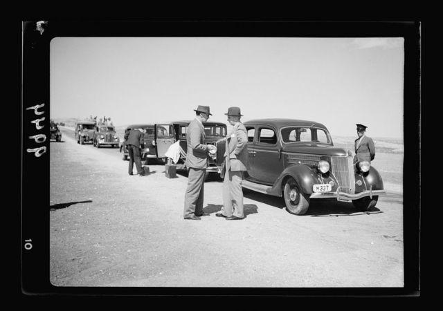 Return of H.E. from London, Sunday Oct. 16, '38. Sir Harold MacMichael landing on Kulundia aerodrome in a Palestine airways machine. H.E. & Mr. Battershil conversing before taking to their cars