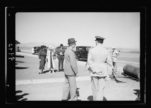 Return of H.E. from London, Sunday Oct. 16, '38. Sir Harold MacMichael landing on Kulundia aerodrome in a Palestine airways machine. H.E. approaching waiting car taking to squadron leader Horis, showing Lady MacMichael seen in distance