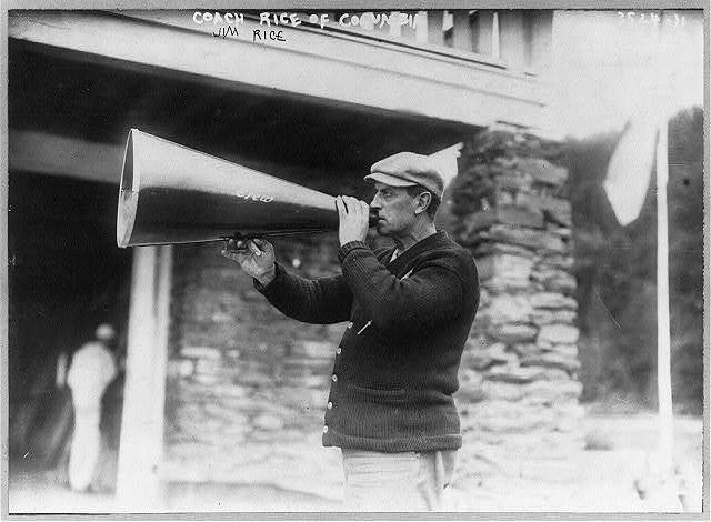 Rowing. Coach Jim Rice of Columbia [holding megaphone to mouth]