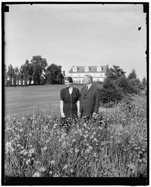 SEC Ickes and bride return home. Olney, Md., June 22. Like a line from the song 'Knee Deep in Daisies and Head Over Heels in Love,' Secretary of Interior Harold Ickes and his bride of a few weeks pictured in the garden of the Ickes country home 'Headwaters' following their return from honeymoon in Europe