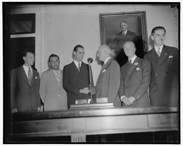 Sec. of State greets Hughes on his arrival in Washington. Washington, D.C., July 21. Sec. of State Cordell Hull, ranking cabinet member in the Capitol, officially greeted Howard Hughes and his crew upon their arrival in the Capitol, they are shown in the office of the Secretary of State, left to right; Richard Stoddard, Lieut. Thomas Thurlow, Howard Hughes, Sec. of State Hull, Harry Conner, and Ed. Lund, 7/21/38