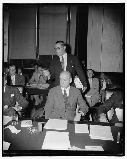 """Secretary of Treasury Morgenthau lauds administration's new lending bill before senate committee. Washington, D.C., July 18. Secretary of Treasury Henry Morgenthau, seated, listens attentively while Edward H. Foley, treasury General Counsel, answers a question by the Senate Banking and Currency concerning the Administration's new lending bill. Morgenthau told the committee the bill was a """"realistic approach to our economic problem."""" He urged prompt approval of it, 7/18/39"""