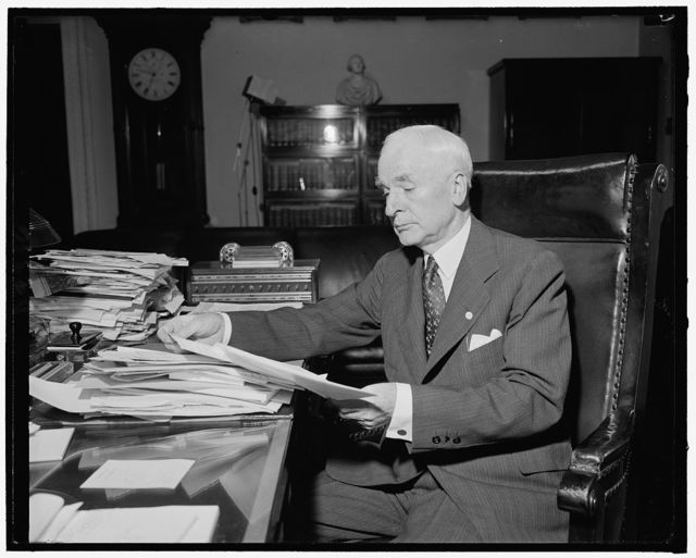 Secy. of State Cordell Hull at his desk, 7-12-40