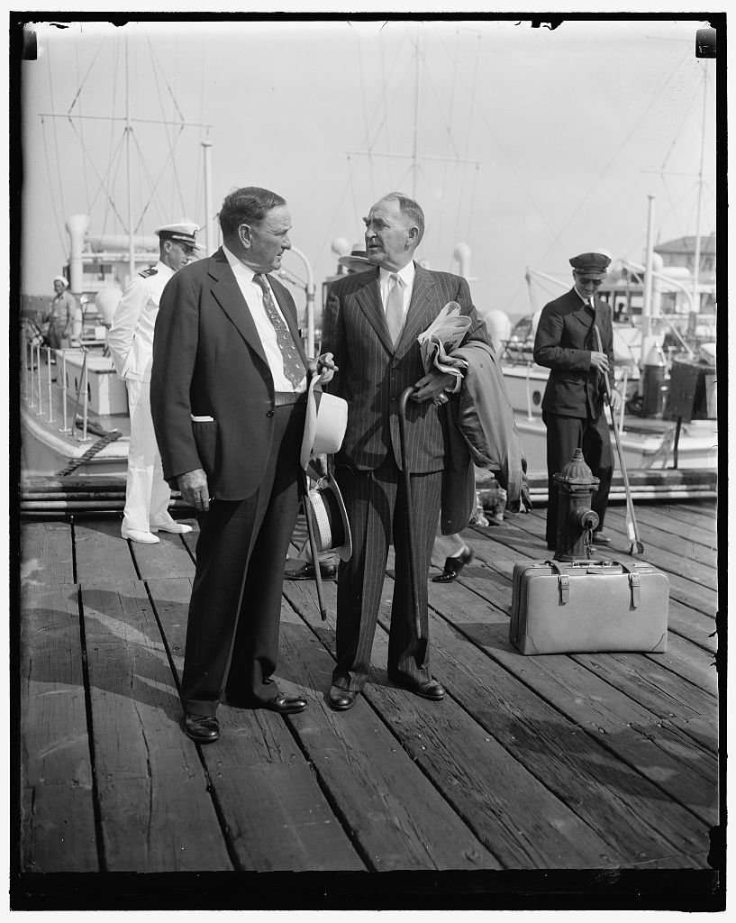 """Senate and House leader leave for Roosevelt political confab. Annapolis, MD, June 25. Senator Joseph T. Robinson, (left) Senate Majority Leader, and Speaker of the House William B. Bankhead, arrive to board the first boat leaving here for Jefferson Island and President Roosevelt's """"Love Feast"""" for Democratic Members of Congress"""