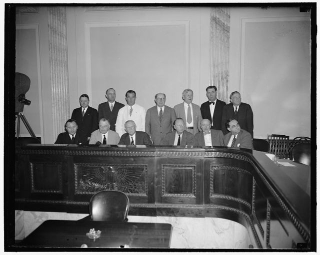 "Senate Military Affairs Committee. Washington, D.C., July 2. The Senate Military Affairs Committee which today be a vote of 14 to 3 approved the nomination [of] Henry Stimson to be secretary of war. Front row, left to right: Senators H. Styles Bridges, New Hampshire; Warren R. Austin, Vermont; Morris Sheppard of Texas, chairman; Robert R. Reynolds, North Carolina; Elbert D. Thomas, Utah; and Sherman Minton, Indiana. Back row, left to right: Senators Chan Gurney, South Dakota; Lister Hill, Alabama; A.B. ""Happy"" Chandler, Kentucky; John Thomas, Idaho; H.H. Schwartz, Wyoming; Edwin C. Johnson, Colorado; and Sheridan Downey, Calif., 7-2-40"