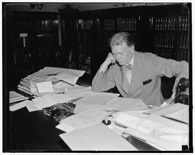 Senator Borah stays on job. Washington, D.C. Aug. 30. While other senators are resting in their home states or visiting vacation spots, Senator William E. Borah, veteran Idaho legislator, remains in Washington and goes to his office every day. He is shown reading his morning mail. 8/30/27
