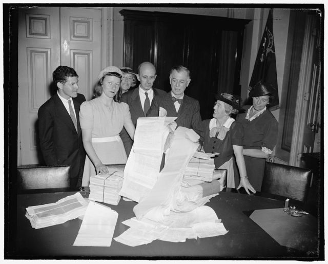 Senator Pittman gets petition urging embargos against Japan. Washington, D.C., July 18. A delegation representing the American Committee for non-participation in Japanese agression, headed by Eleanor Fabyan of Boston, called on Senator Key Pittman, Chairman of the Senate Foreign Relations Committee, this afternoon to present petitions urging embargoes against Japan. Miss Fabyan said the petitions were signed by 300,000 persons. Left to right: Gabriel Lasker, Cambridge; Gertrude Ely, Phila., PA; Eleanor Fabyan, Boston, Mass.; Dr. Roger Greene; Senator Pittman; Mrs. George Fitch, Pasadena, Cal.; Mrs. Joseph Exter, Chicago, Ill.; Dr. Greene is Chairman of the organization, 7/18/39