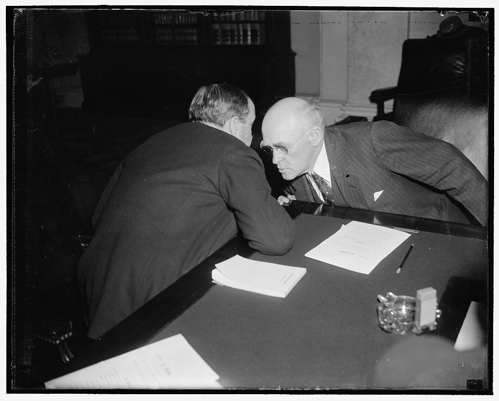 Senatorial huddle. Washington, D.C., Feb. 24. Like Moslems in prayer these two Senators, Robert J. Bulkley of Ohio, and John H. Bankhead, of Alabama, huddled during a lull at Senate Banking and Currency Subcommittee on the Bulkley Bill providing for $6,000,000,000 system of superhighways in the U.S., financed by tolls, 2/24/38
