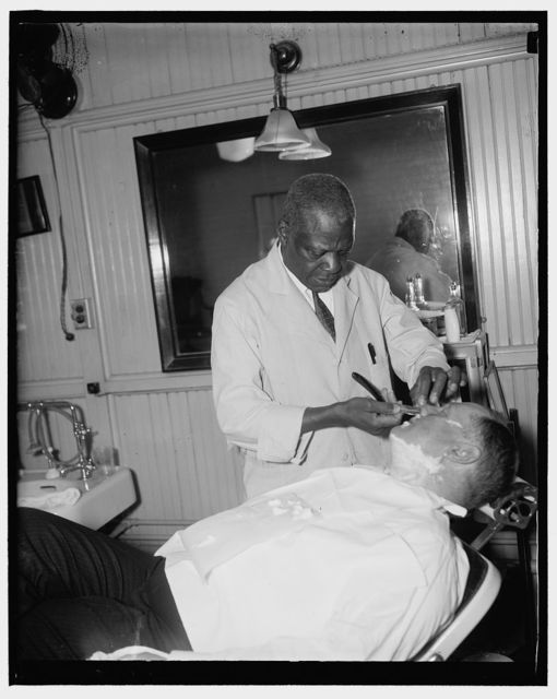 Senatorial shave. Washington, D.C., Jan. 6. Senator Fred H. Brown, new Democratic Senator from New Hampshire, gets a last minute shave before going in the House chamber to hear President Roosevelt address the joint session