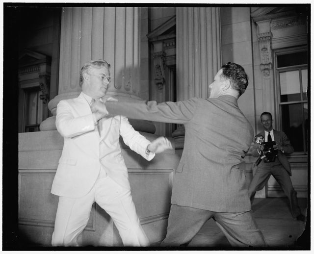 Senators in playful mood. Washington, D.C., June 15. It wasn't all work and no play for all of the Senators today as the Senate pushed through last minute bills to speed adjournment. Senator F. Ryan Duffy, (left) Wisconsin, engages in a sparring match with Senator Allen Ellender, Louisiana, as their colleagues debated the conference report on the $375,000,000 flood control bill, 6/15/38