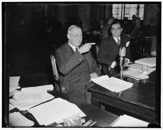 Senior Morgan Partner appears before National Monopoly Committee. Washington, D.C., Dec. 15. George Whitney, Senior Partner of J. Pierpont Morgan & Co., was questioned by the National Monopoly Committee today regarding the relationship of the Morgan firm with the American Telephone and Telegraph Co. The Morgan Co. underwrite almost $2,000,000,000 of bonds for the A.T. & T. during the last 33 years. Whitney described the investment banking business as 'competitive as the dickens'