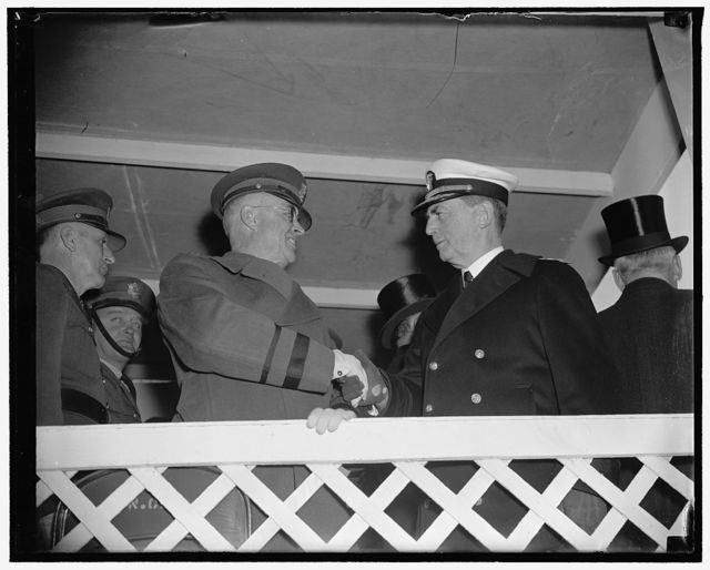 Service chiefs review army day parade. Washington, D.C., April 6. Maj. Gen. Malin Craig, U.S. Chief of Staff, greets Rear Admiral William D. Leahy, Chief of Naval Operations, just before both reviewed with President Roosevelt today's Army Day Parade in the Capitol, 4/6/38