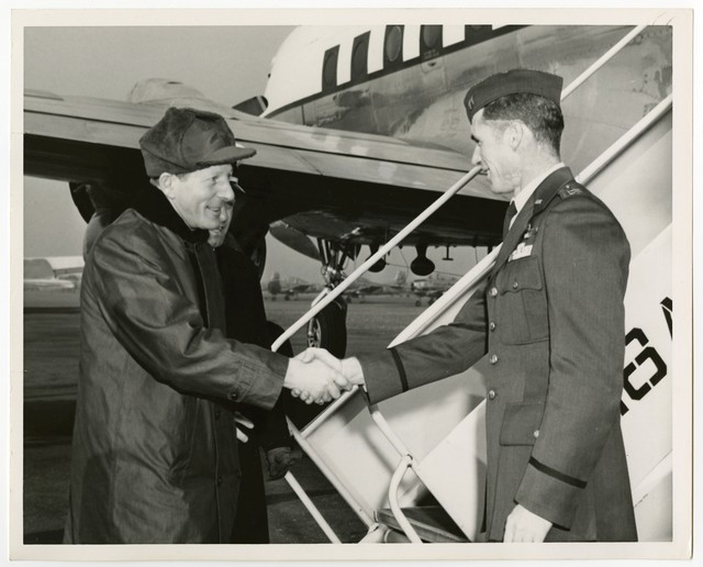Singer, Comedian Danny Kaye greets his pilot, Air Force Capt Richard Cole as he prepares to depart the Republic of Korea at K-16 Airport