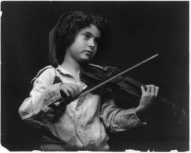 [Small child playing violin]