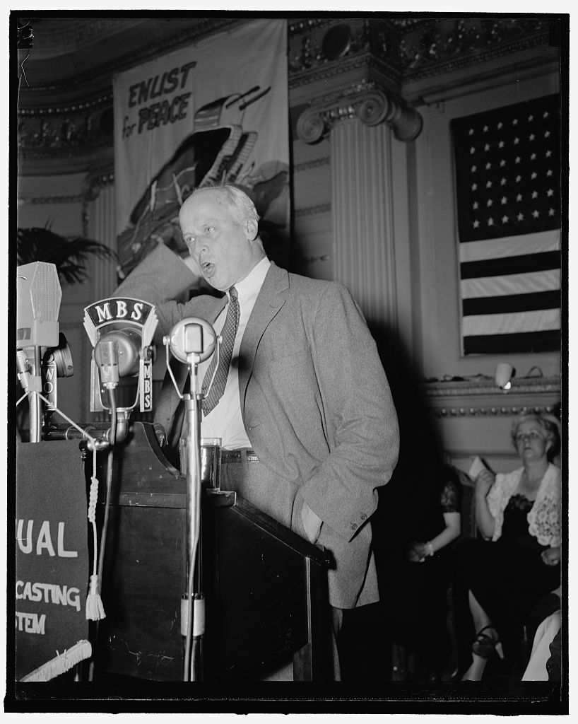 Socialist Norman Thomas at peace rally. Washington, D.C., June 8. 1,100 people crowded into an antiwar mass meeting held here last night. Condemnation of 'war hysteria' and defense policies were voiced by leaders of congressional, labor, student, and women's groups. Norman Thomas, socialist candidate for Presidency, urged the establishment of camps in this country to care for European refugees. He warned against 'hysterical armament economics - unnecessary for the protection of our homes' - and declared American civil liberties had already been infringed upon by 'war hysteria'