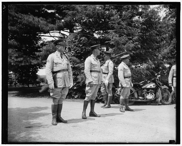 Soldiers guard Dupont home. Wilmington, Del. July 1. A cordon of soldiers aided state troopers in guarding the entrance to Owl's Nest, Dupont estate, as guest arrived for the Roosevelt-Dupont wedding yesterday, 7/1/37