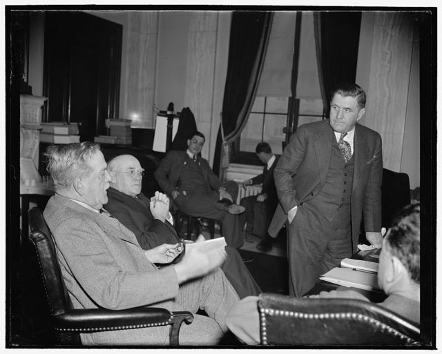 Southern farmers demand basic principles of New Deal Farm Program be retained. Washington, D.C., Jan. 9. As two southern Senators Ellison D. Smith, left, of South Carolina, Chairman of the Senate Agriculture Committee, and John H. Bankhead of Alabama, listen intently, Ranson Aldridge, President of the Mississippi Farm Federation, today told a group of Senators and Representatives that southern farmers want the basic principles of the New Deal Farm Program retained but at the same feel that additional funds should be allotted for benefit payments to producers, 1/9/39