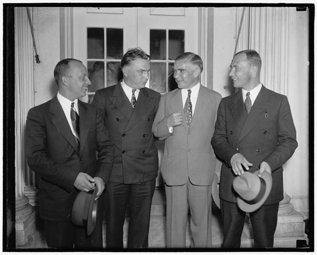 Soviet Flyers at White House. Washington D.C June 28. The three Soviet Flyer who conquered the North Pole route between the U.S.S.R. and the United States are shown leaving the White House today after being received by President Roosevelt. In the photograph, left to right: George Baiduckcv, co-pilot; Valeri Chkalov, Pilot; Alexander Beliakov, navigator. 6/28/37