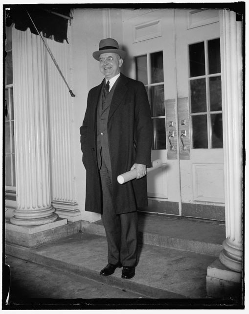 Stanley Reed receives commission. Washington, D.C., Jan. 27. Stanley Reed, photographed as he left the Executive offices of the White House, where President Roosevelt today personally handed t o him his commission to the Supreme Court, 1/27/38