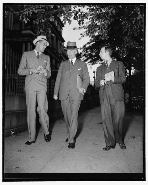 State Secretary pressed for latest news on European situation. Washington, D.C., Sept. 26. Leaving the White House today after listening with President Roosevelt to Hitler's speech, is accompanied to his office by reporters seeking latest news on the European situation, 9/26/38