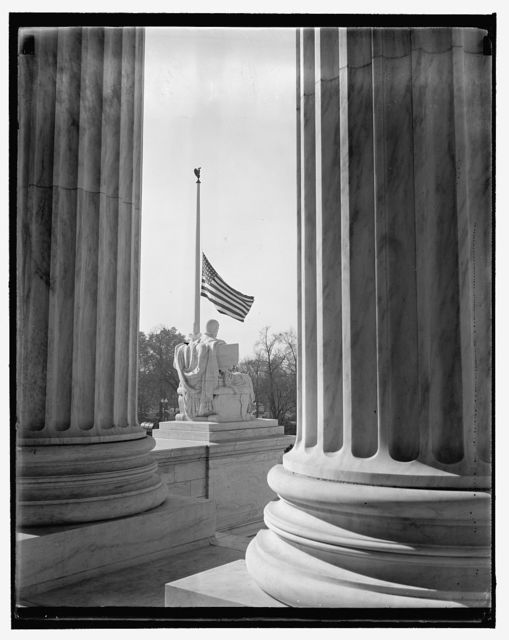 Supreme Court flag half-masted out of respect to dead jurist. Washington, D.C., Nov. 16. Scene thru the pillars of the U.S. Supreme Court Building showing the flag at half-mast out of respect to Justice Pierce Butler, who died this morning after a long illness